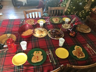 Snowman pancakes, eggs, bacon, and oatmeal.